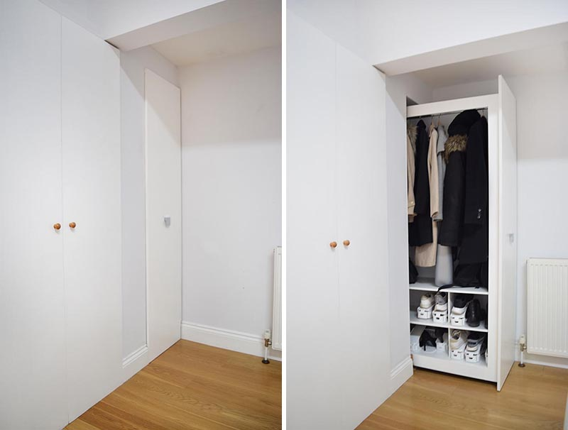 Stepping inside this renovated home, there's a small and narrow entryway, where the designer integrated a pull-out cabinet that would be easy to use and have enough capacity for several coats and shoes in its lower area. #CoatCloset #EntrywayCloset #PullOutCloset