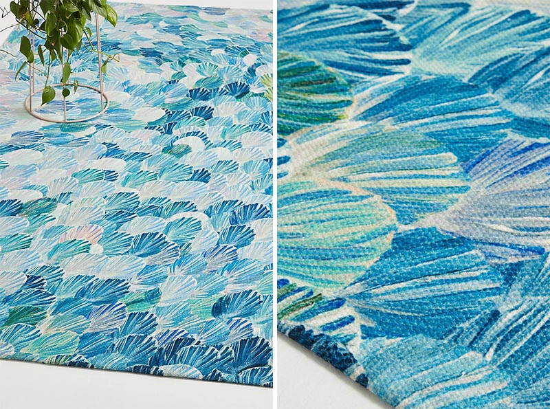 Outdoors, like on a patio or balcony, is a place where people don't often think they can include a rug, but they're ideal for creating a designated zone in an open space. #OutdoorRug #ModernOutdoorRug #BlueOutdoorRug #Decor