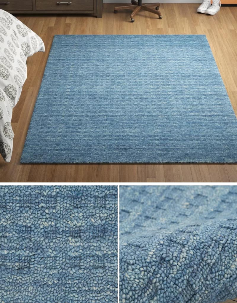 Displaying a textured rug in your interior can help to create dimension. #BlueRug #ModernRug #HomeDecor #DecorIdeas