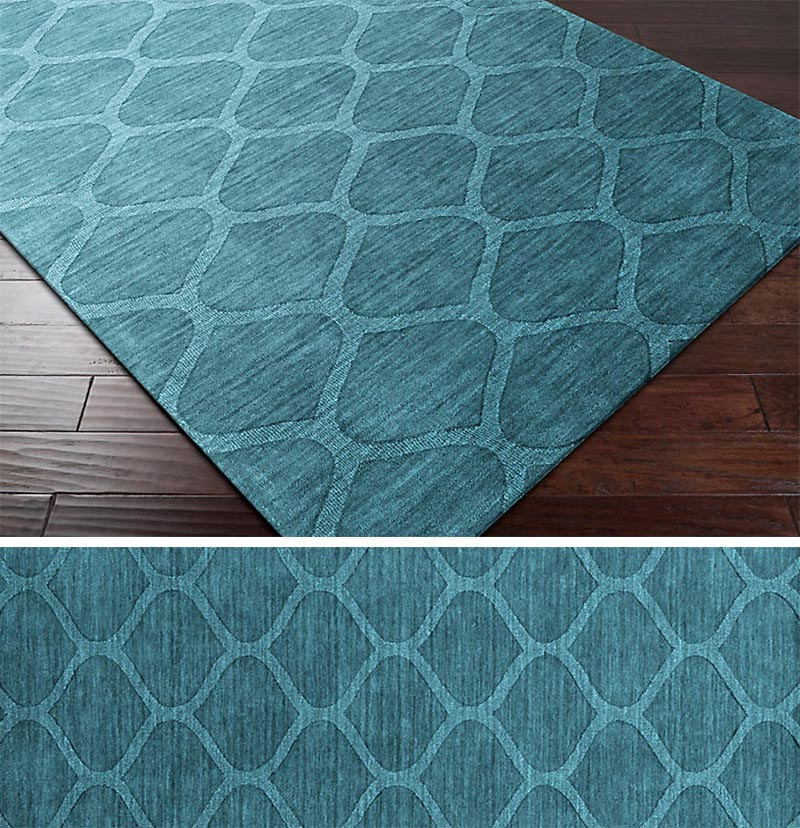 A rug is a way of introducing a pattern to any modern interior. By keeping the color and pattern simple, it allows the rug to add a subtle design element that doesn't distract from the overall look of the room. #ModernRug #PatternedRug #BlueRug #HomeDecor