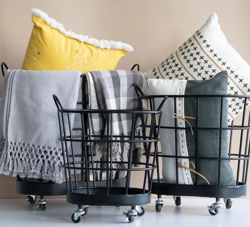 Mobile storage is an easy way to keep your blankets and pillows organized, plus they are quick to move to another room if you have people coming over and need more floor space. #MobileStorage #StorageBin #MobileBin #BlanketStorage