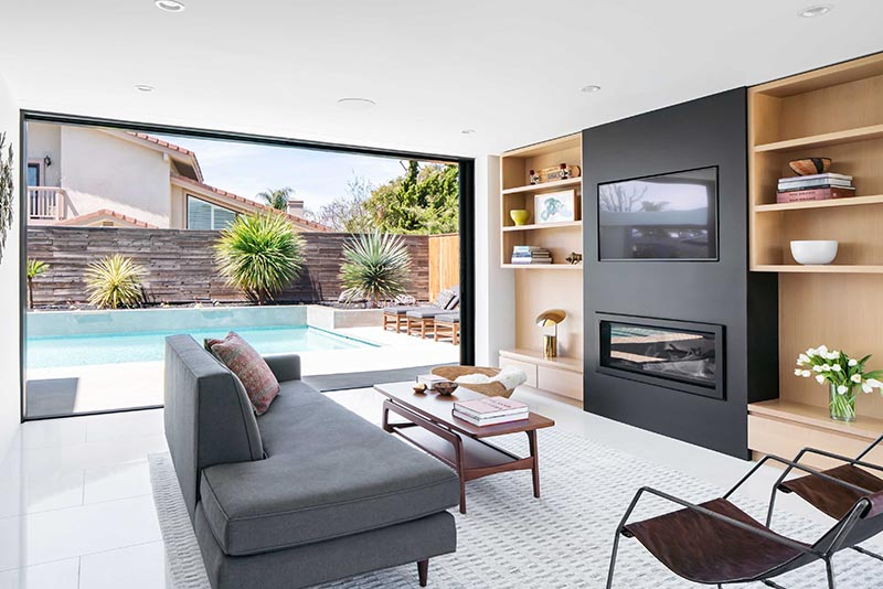 The Whole Wall Is A Sliding Glass Door That Opens The Living Room To The Backyard