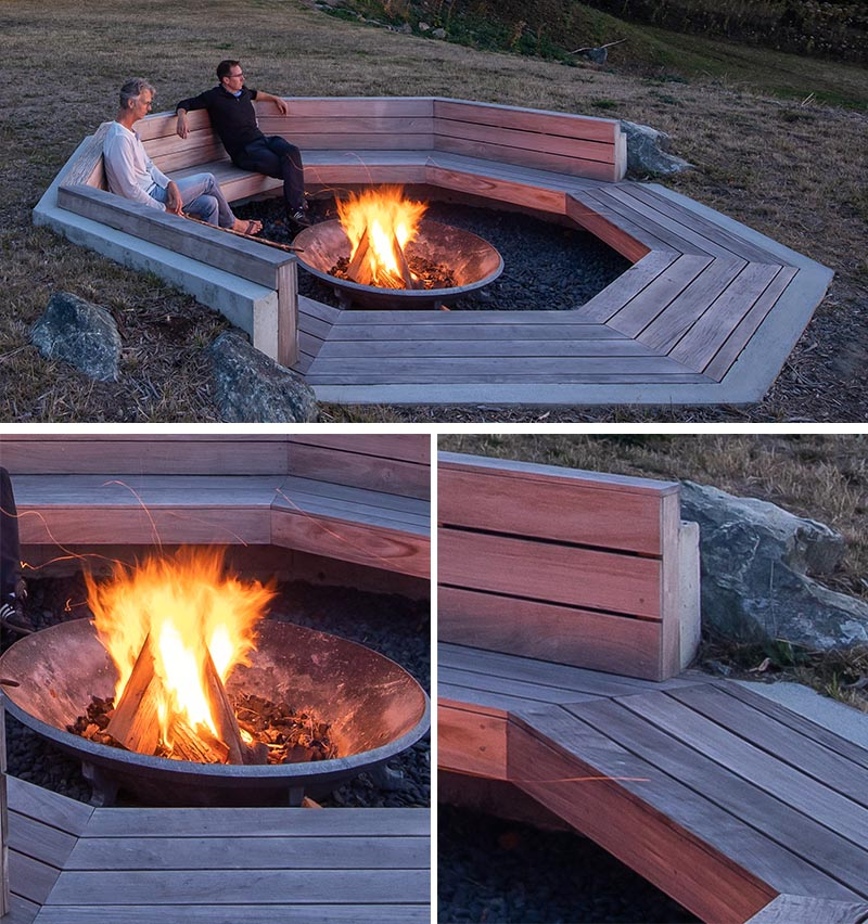 A octagonal outdoor fire pit has a wood bench that wraps around it.