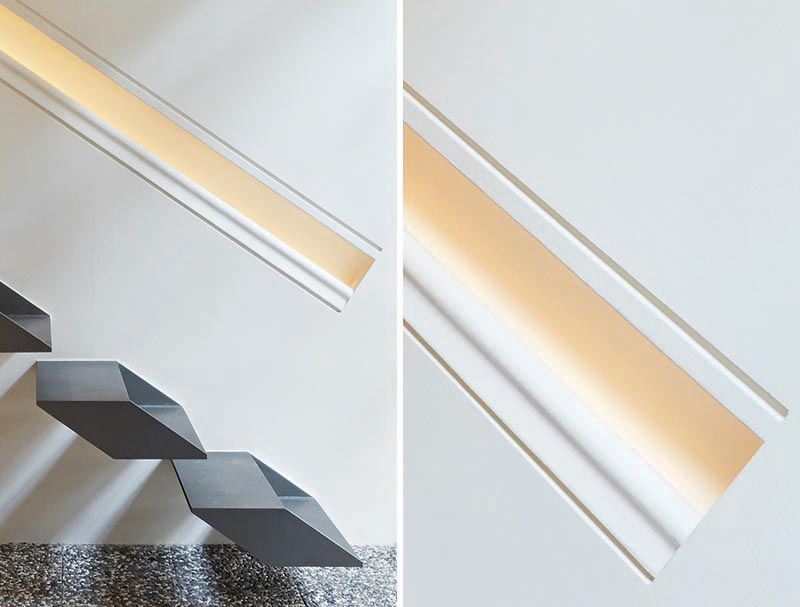 The handrail, which has been built directly into the wall and is the same length as the stairs, provides a guide for people using the stairs as it also has hidden lighting. #Handrail #HiddenLighting #Interiors #Lighting #HandrailLighting #StairDesign