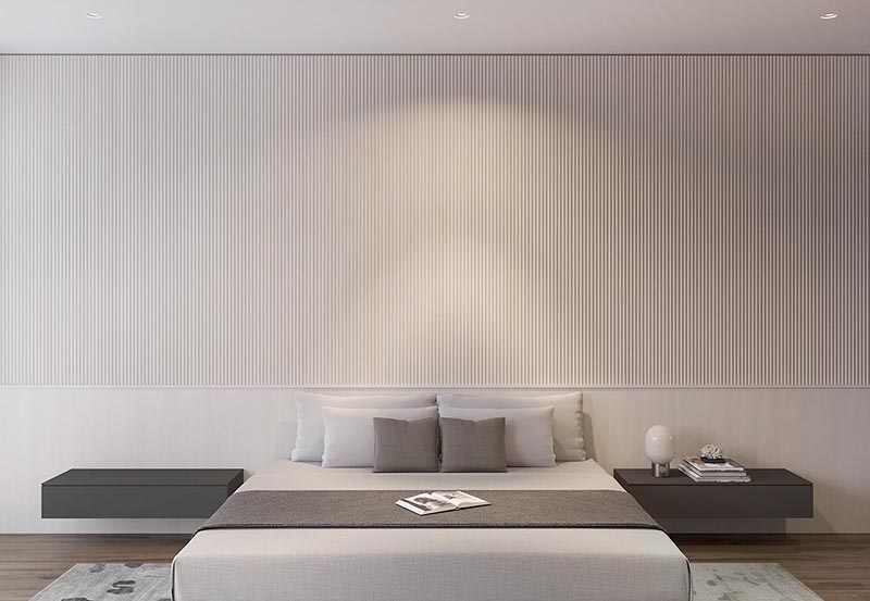Using wood dowels, the designers of this modern bedroom created a textured accent wall, keeping the lower third as a backdrop for the bed and floating side tables. #WoodAccentWall #TexturedAccentWall