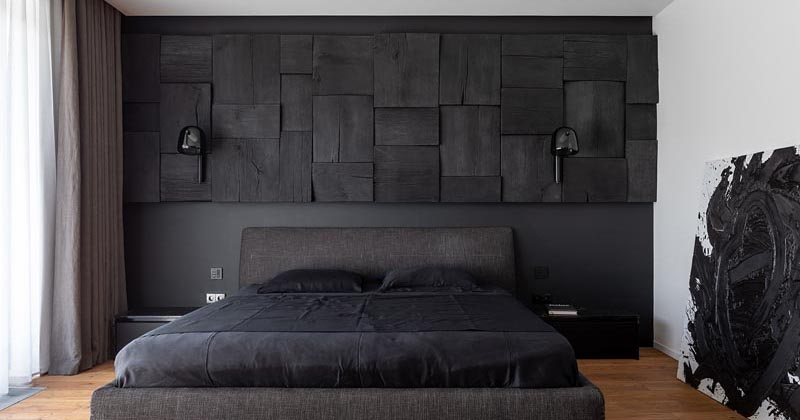 A Blackened Wood Accent Wall Provides Some Creative Texture In This Bedroom