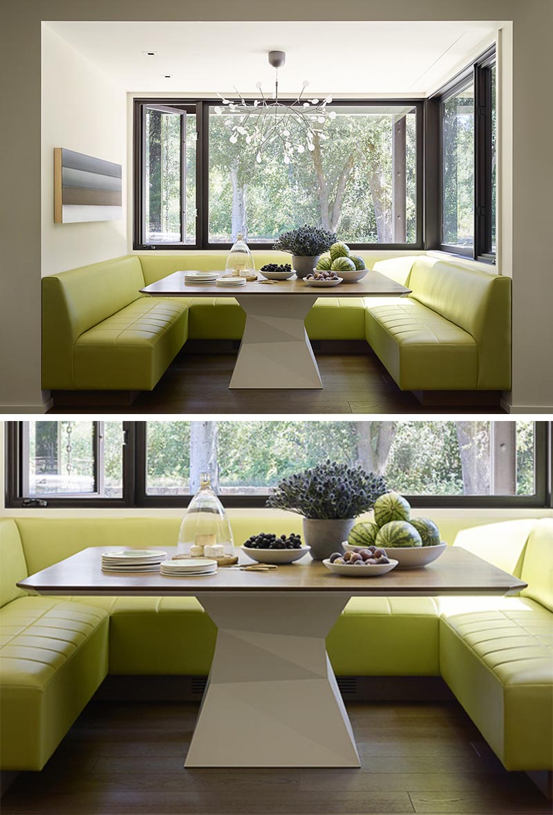 A built-in dining nook with wrap-around banquette seating in a lime green.