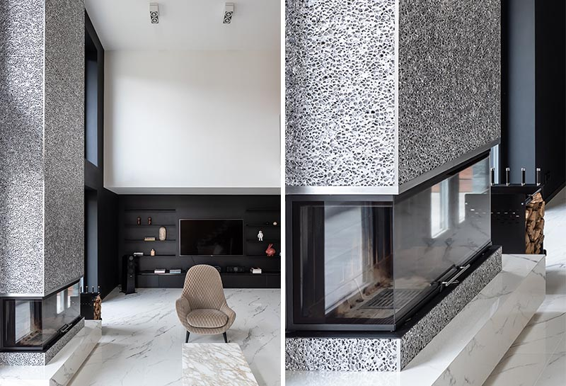 Sergey Makhno Architects recently completed a new house, and as part of the living room, they created a modern fireplace surround made from metal lace. #ModernFireplace #MetalFireplace #LivingRoom #MetalFireplaceSurround #Interiors #FireplaceDesign