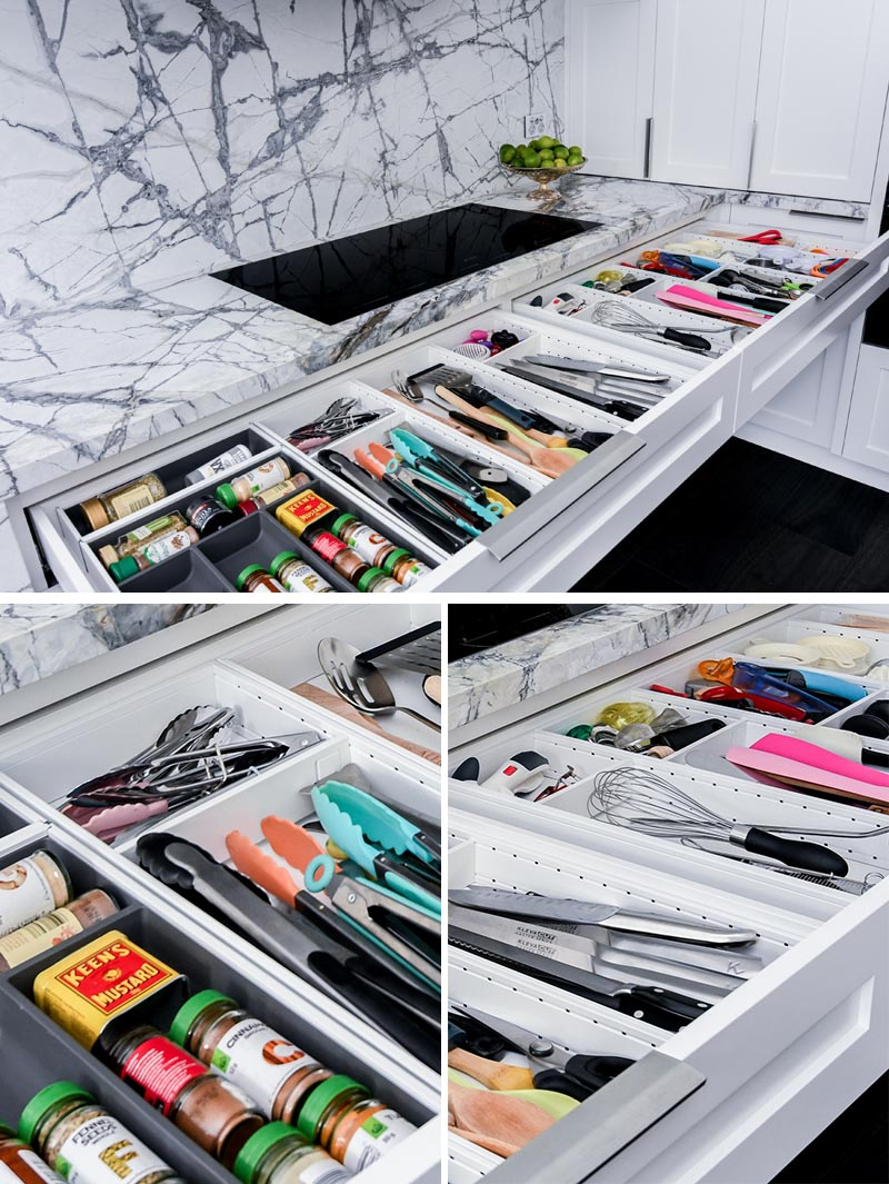 Underneath the induction cooktop in this modern kitchen, is a pair of neatly organized drawers with everything you need when cooking, like spices, tongs, spatulas, and other little cooking gadgets. #KitchenDesign #KitchenIdeas #KitchenStorage #KitchenOrganization