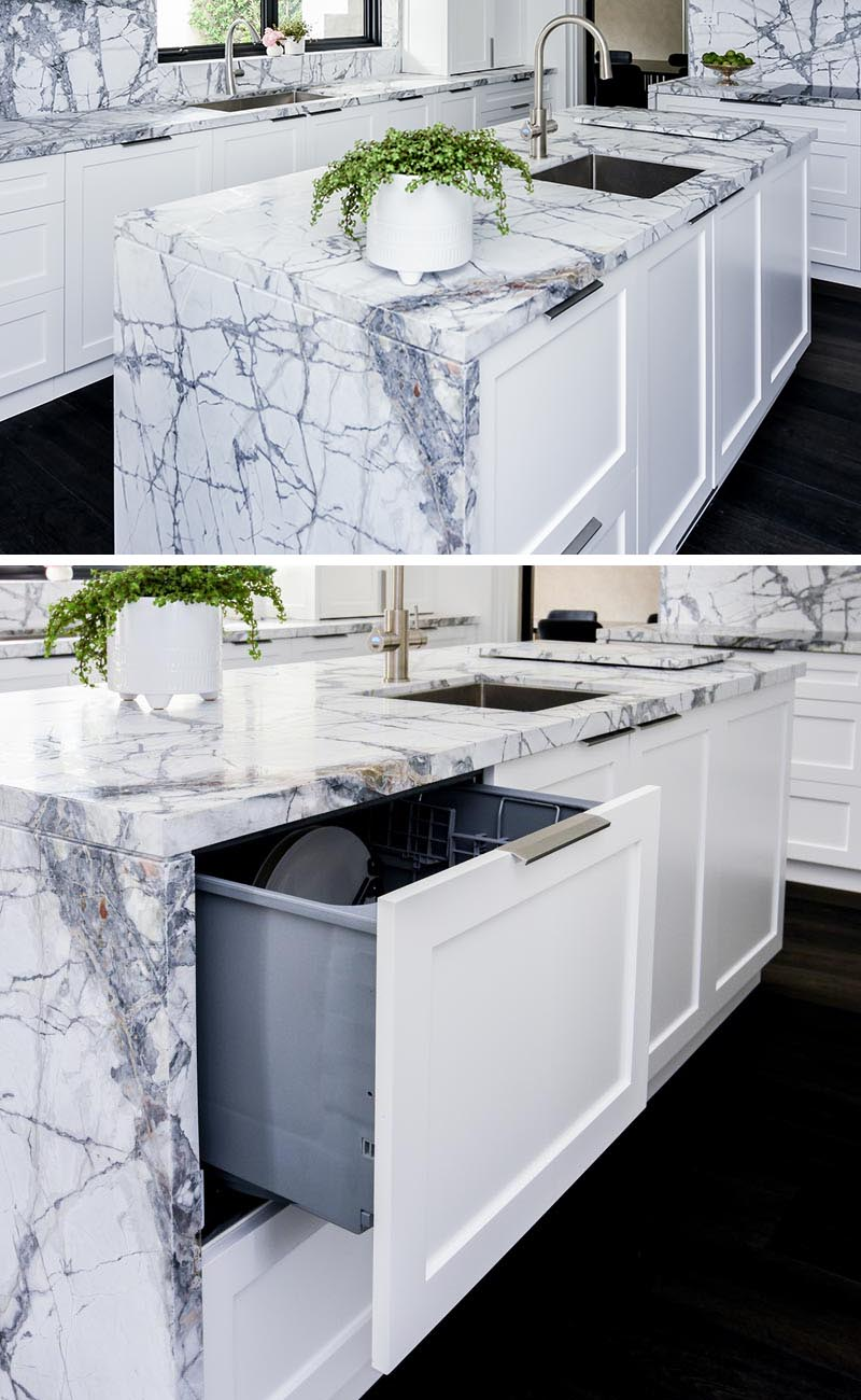 This modern kitchen island has a hidden dishwasher disguised as a drawer. #HiddenDishwasher #IntegratedDishwasher #KitchenDesign #KitchenIdeas