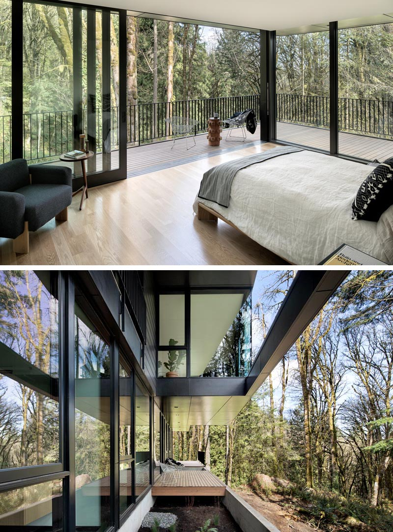 This modern master bedroom has sliding glass doors that open directly to the balcony, creating an indoor / outdoor space that overlooks the trees. #GlassWalls #MasterBedroom #ModernBedroom #Windows