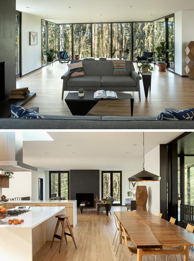 Inside this modern home, the main social areas of the house are open plan, with the living room taking advantage of the view through floor-to-ceiling windows. The interior also features white oak floors that have dark walnut inlay borders. #ModernInterior #LivingRoom #Windows #OpenFloorPlan #OakFloors