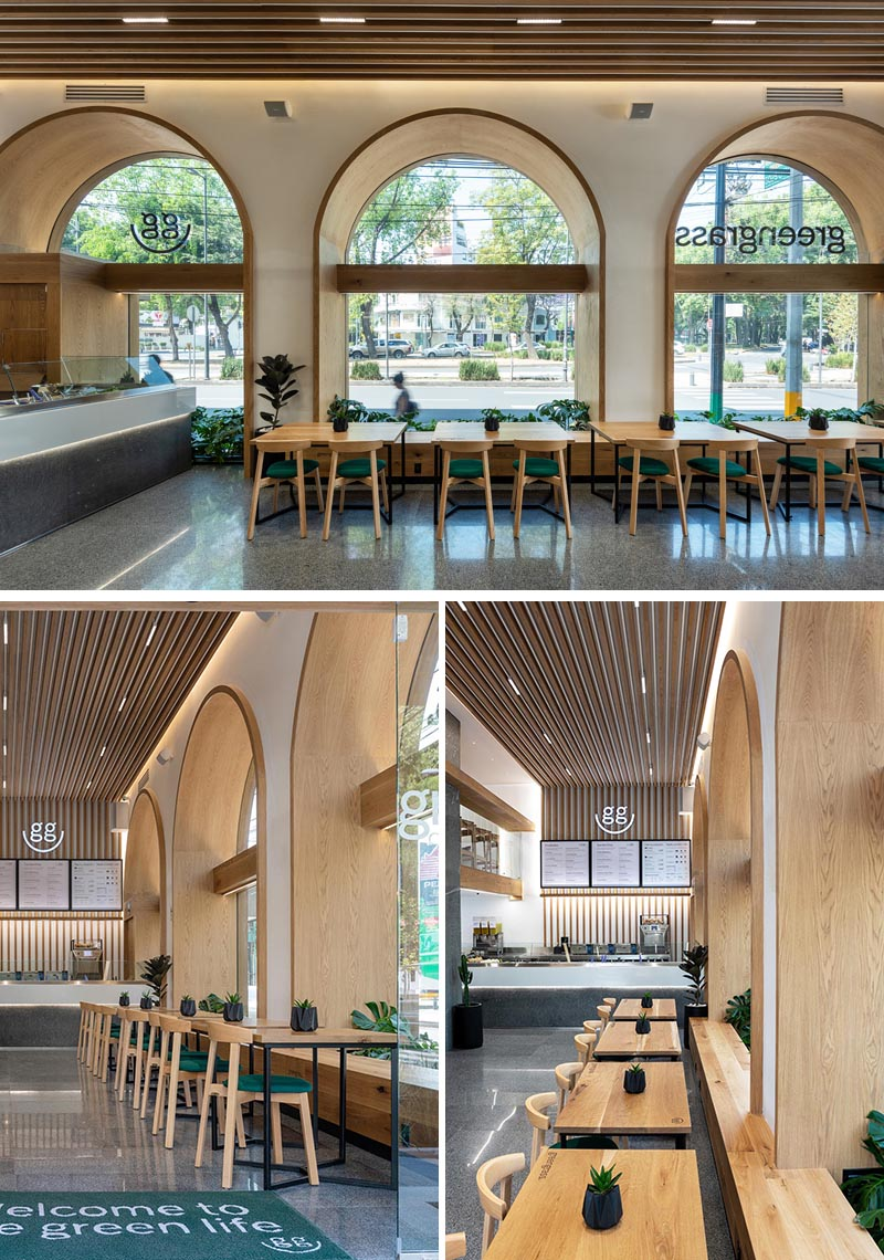 Wood-lined arches with matching windows create alcoves that are deep enough to include plants and a bench seat. #RestaurantSeating #RestaurantWindows #InteriorDesign #WoodArches #ArchedWindows