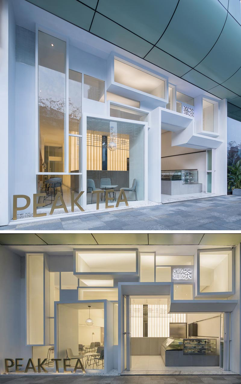 This modern tea store features a facade made up from white boxes that provides a glimpse of the bright interior and adds to the interest of the building. #TeaStore #CafeDesign #FacadeDesign #RetailFacade