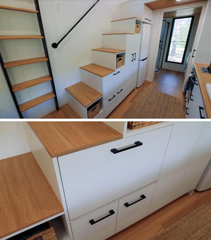 This modern tiny house has a set of stairs with storage that lead up to the lofted bedroom above the bathroom. #TinyHouse #TinyHouseStairs #StairsWithStorage