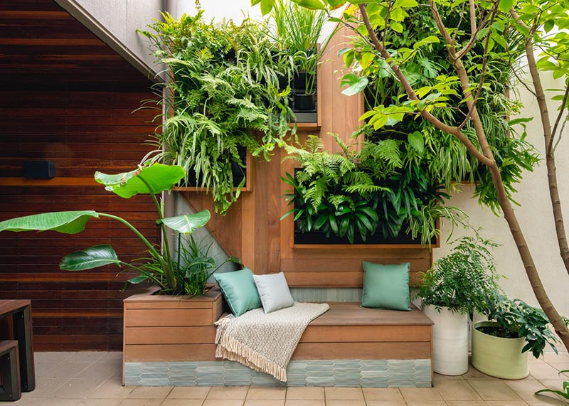 Wall Planters Provide A Low Maintenance Garden For This Small Courtyard