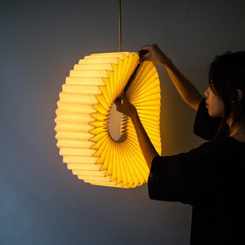 Mobius Pendant Lamp by Nhi Ton.