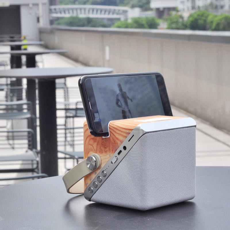 Twist Cube Wireless Charger with Bluetooth Speaker by Fai Leung