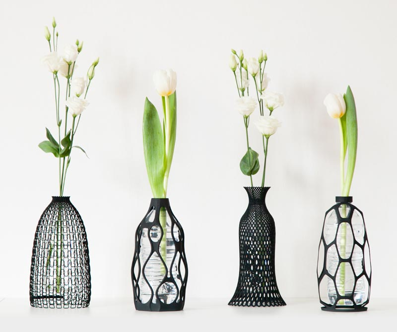 3D printed vases with a black silhouette.