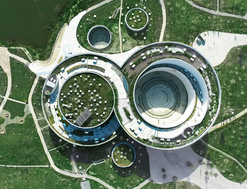 A circular building with a figure eight design.
