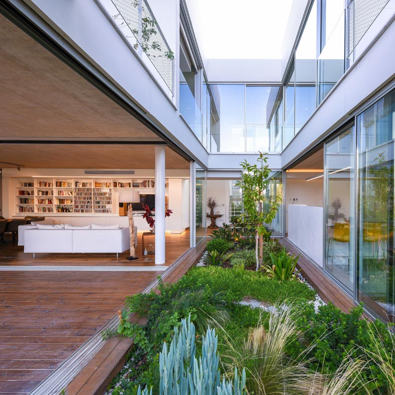 A house has walls that open to a garden.