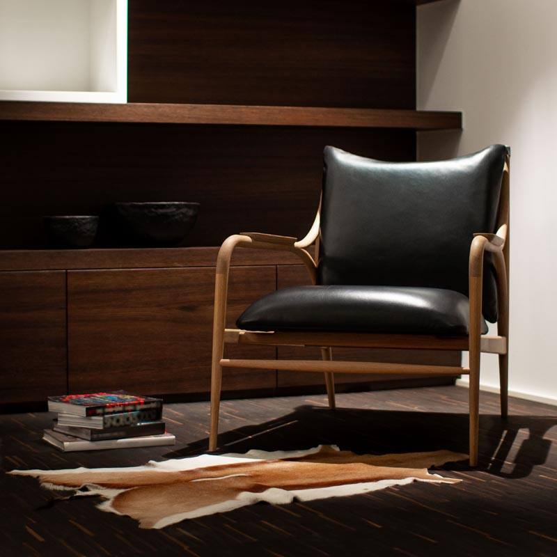 A leather and wood armchair.