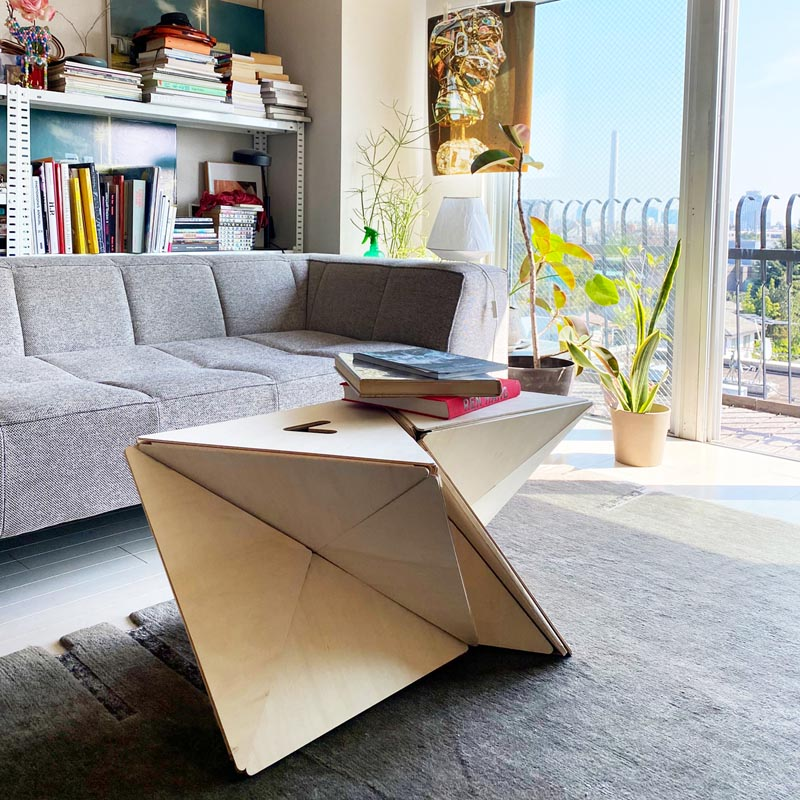 A modern folding stool that doubles as a table.