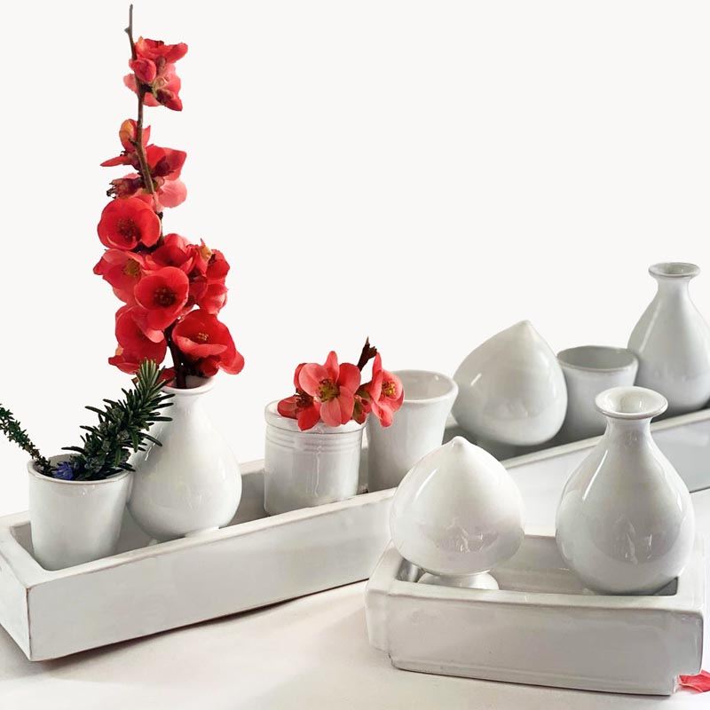 A collection of small white modern vases.