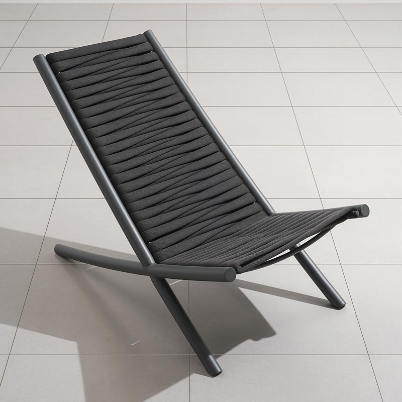 A modern black chair with woven seat.
