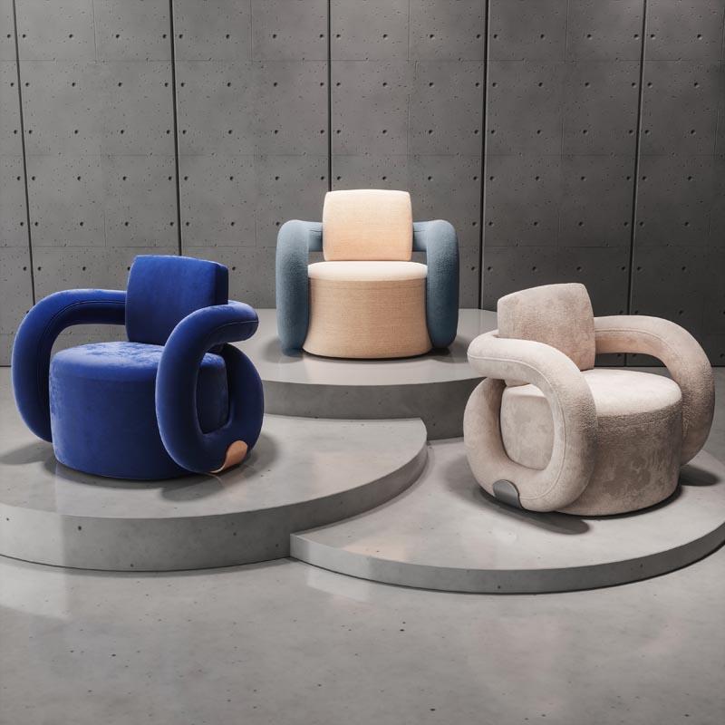 A modern upholstered armchair.=.
