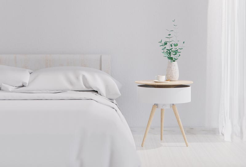 A modern white and wood bedside table.