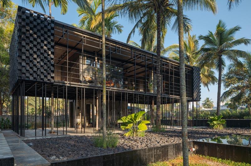 A modern weekend getaway house on poles.