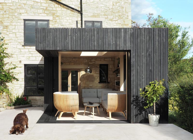 George King Architects has designed a modern reading room as a small extension on a 17th century cottage in the Cotswolds, England. #ModernArchitecture #SmallExtension #ReadingRoom #HomeOffice