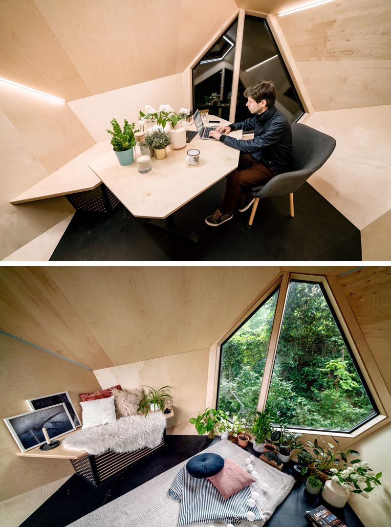 The inside this backyard home office, which can also function as a guest room or a playroom for kids, is lined with natural Scots pine wood, is insulated, has built-in A/C, and strips of lighting on the angular walls, as well as a built-in desk with electrical outlets. #BackyardHomeOffice #BackyardStudio #BackyardGuestSuite #HomeOffice
