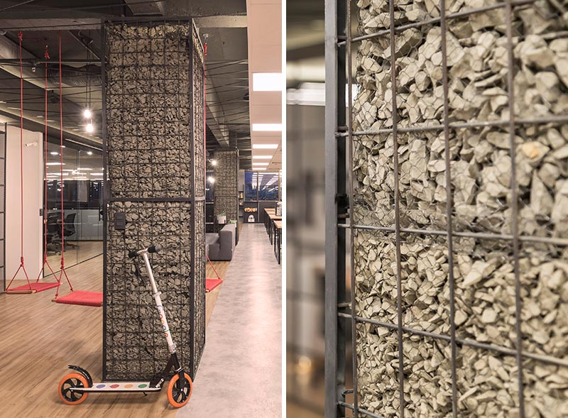 Columns, whether they're in the workplace or at home, are often left as raw concrete or simply painted, however in this office the columns have been turned into feature accents named gabions. #Gabion #WorkplaceDesign #Columns