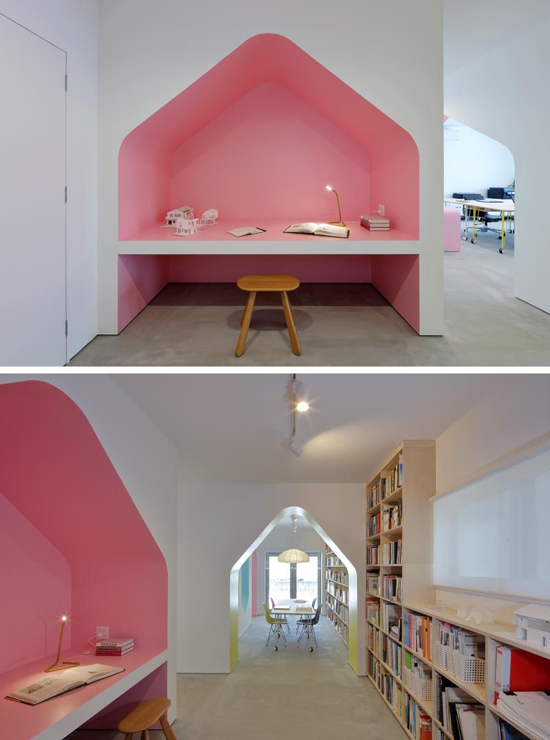 This modern design studio has a desk built into a alcove that's been painted pink. #Desk #BuiltInDesk #DeskIdeas #HomeOffice #Pink
