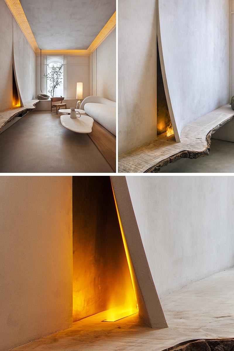 Architecture and interior design studio Lorna de Santos, has recently completed a room that features a small fireplace hidden behind a split in the wall. #SmallFireplace #InteriorDesign
