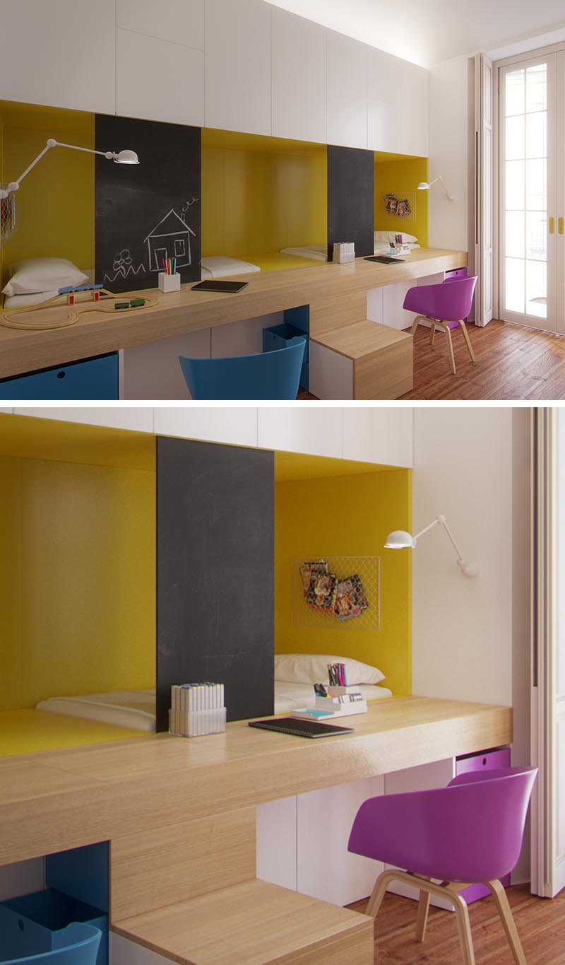 This modern shared kid's bedroom has two beds that are nestled behind the built-in desks, with the desktop forming part of the stairs to reach the beds. The sleeping niche is highlighted with yellow, while above, white cabinets provide storage, and safety screens double as a chalk board for the children to draw on. #KidsBedroom #SharedBedroom #BedroomIdeas #BuiltInBeds #BuiltInDesks
