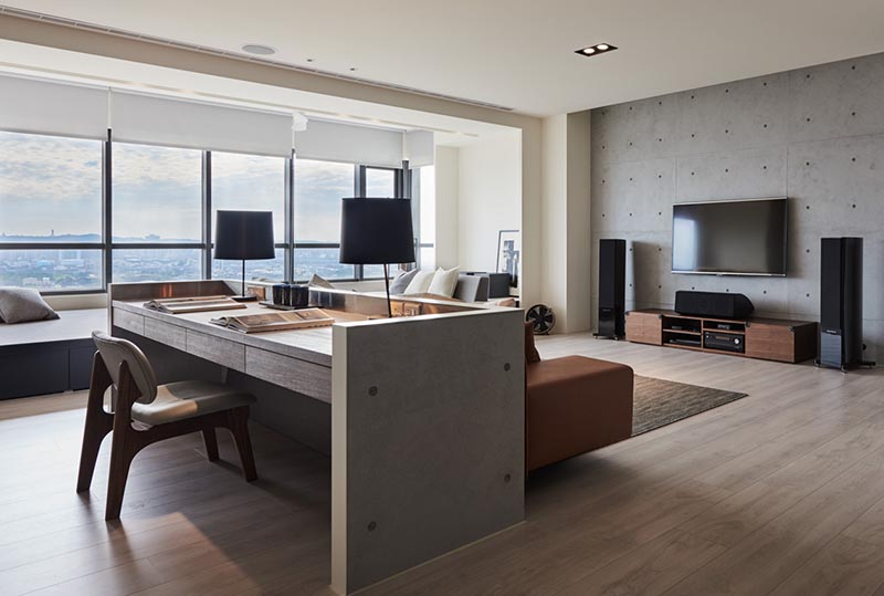 Design firm CAC square together with Guan Pin have designed a modern living room for an apartment in Taiwan, that makes use of the open floor plan to include a dedicated home office. #HomeOffice #WorkAtHome #LivingRoom #Interiors