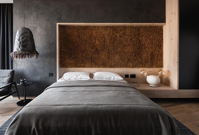An Accent Wall Made From Reed Stems Adds Texture To This Bedroom