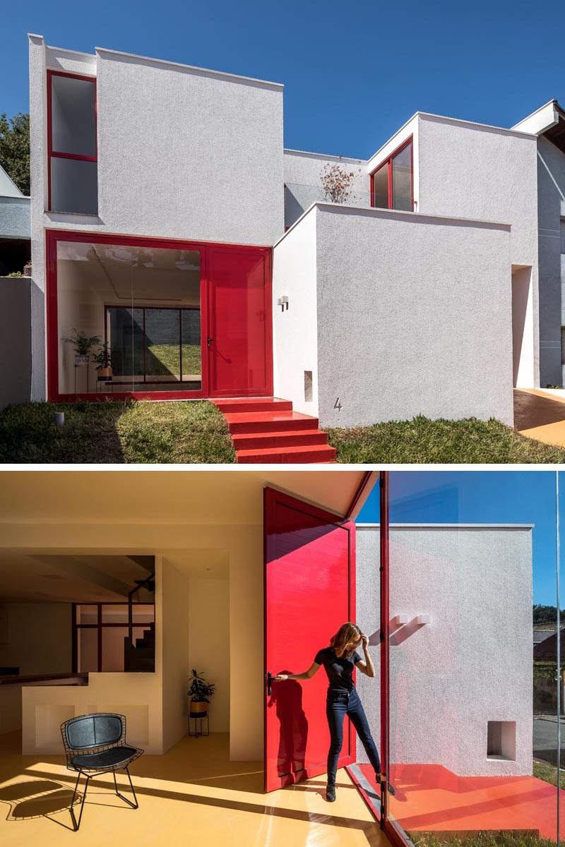 The red front door and window frame provide a pop of color to this modern white house, and match the steps that lead connect to the sidewalk. #RedFrontDoor #RedFrontSteps #RedWindowFrames