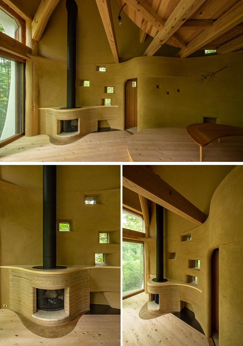This small house has a fireplace that curves out from the wall, with its surround made from rammed earth. #Fireplace #RammedEarth #InteriorDesign