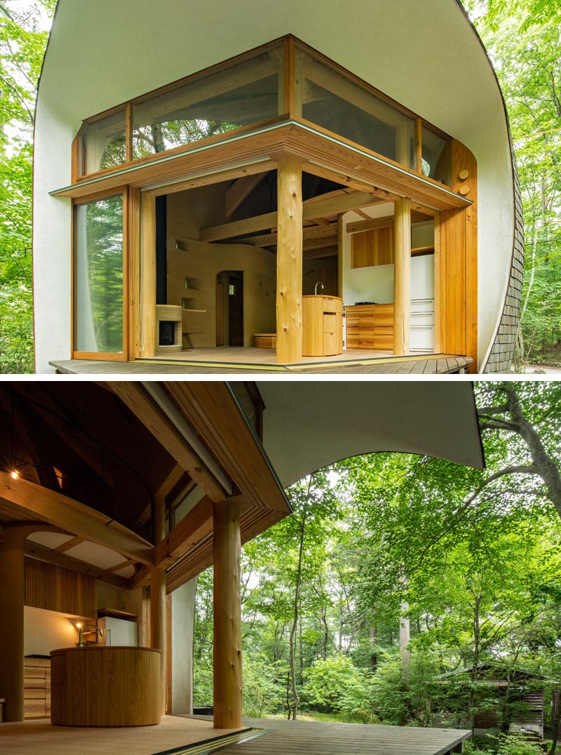 This small house has large sliding doors that help to create an indoor / outdoor living experience, and allow the occupants to enjoy the nature that surrounds the home. #SmallHouse #Architecture #Doors #CurvedHouse