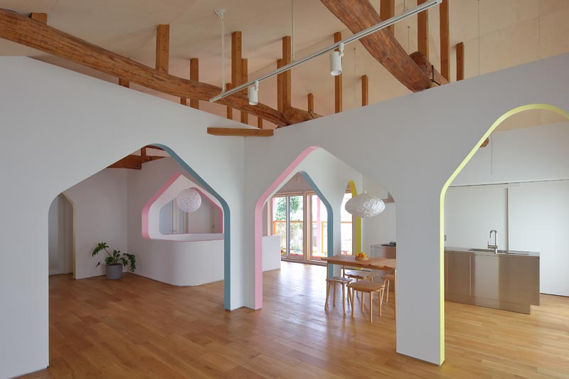 Arches Accentuated By Soft Pops Of Color Add A Whimsical Element To This Space
