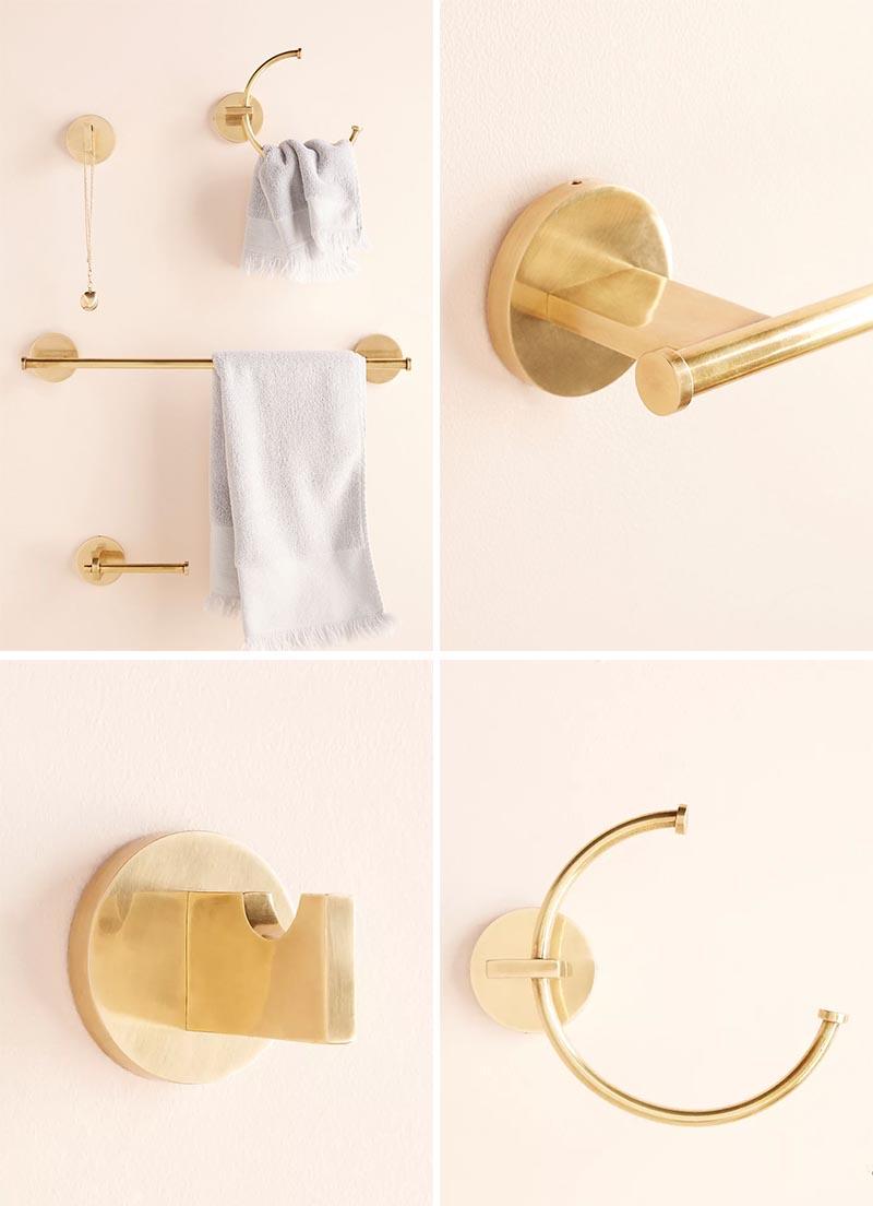 Modern metallic bathroom hardware with a brass finish.