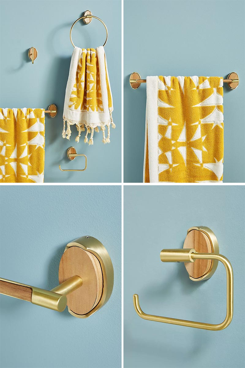 Modern metallic bathroom hardware made from bronze with a teak accent.
