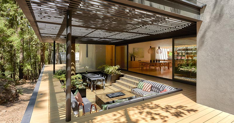 A Covered Outdoor Conversation Pit Makes Room For A Lounge, Fire Table, Planters, And A Dining Area