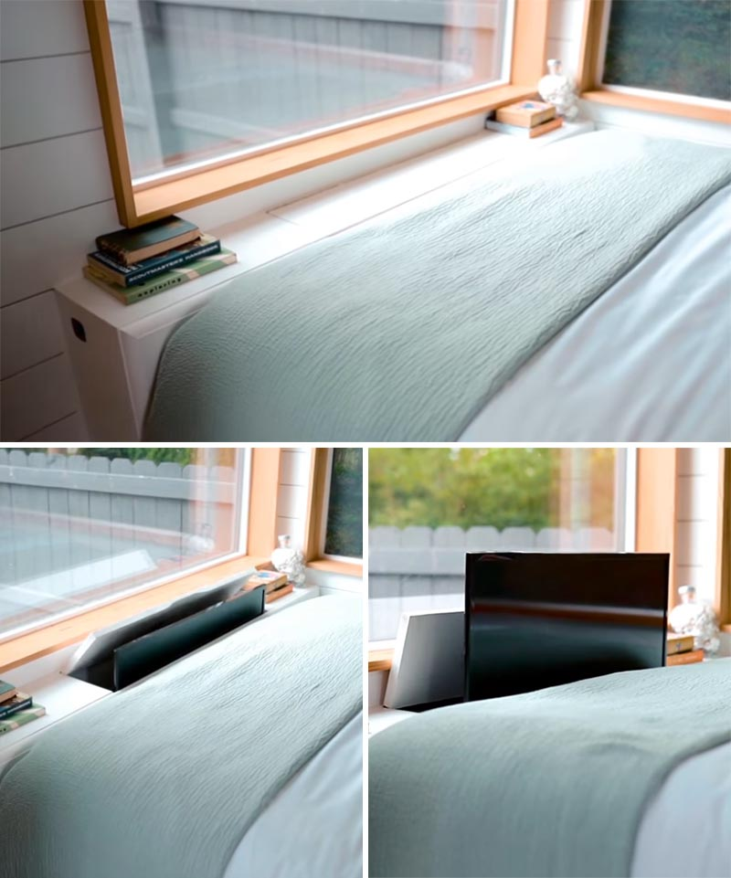 A television is hidden within a white cabinet at the end of this bed.