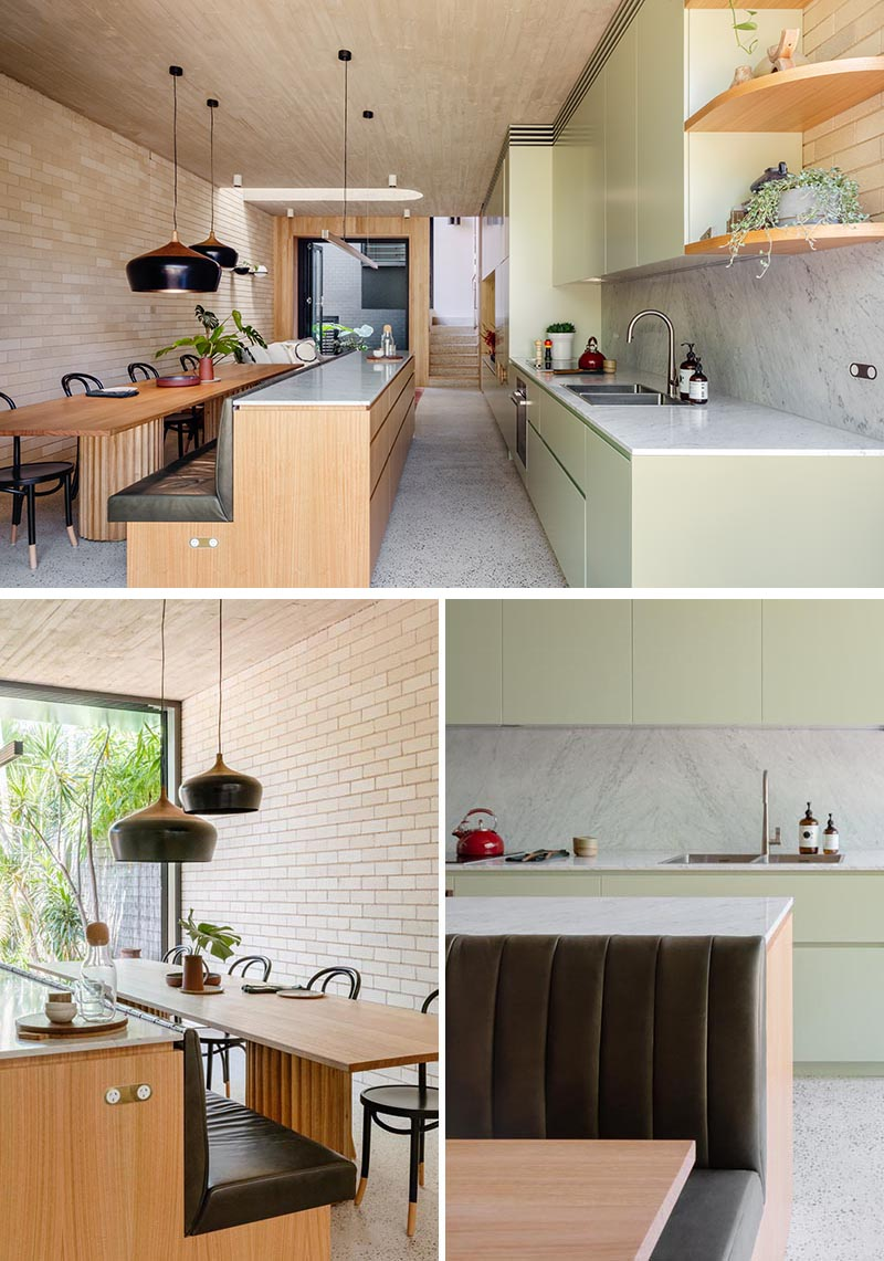 This Kitchen Island Saves Space In A Narrow Interior By Including Built In Banquette Seating