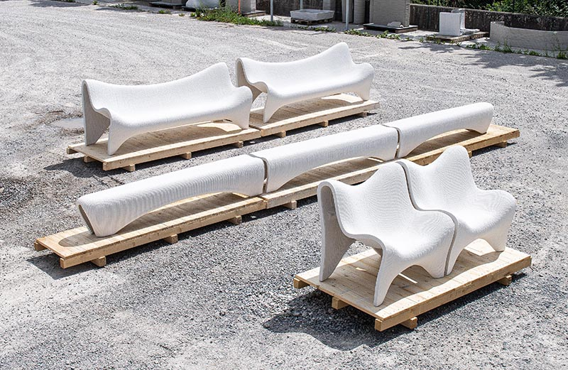 A modern outdoor furniture collection made from 3D printed white concrete.